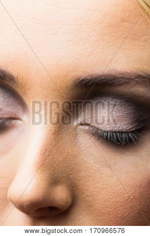 Focus on eyes makeup with closed eyes in a studio