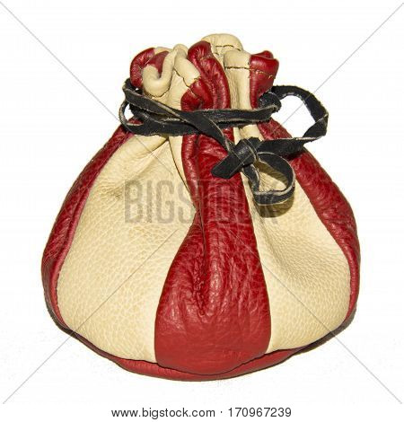 Red and beige pouch closed with leather string on the white background. The thing from The Middle Age.