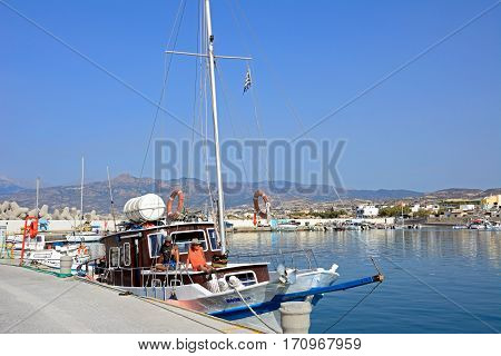 IERAPETRA, CRETE - SEPTEMBER 18, 2016 - Couple on a yacht moored in the harbour with views towards the mountains Ierapetra Crete Greece Europe, September 18, 2016.
