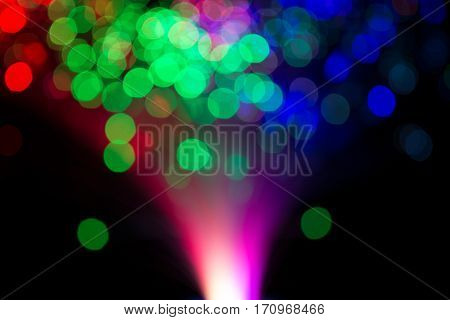 Defocused twinkling lights, bokeh blure at night on black background