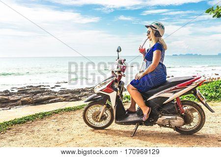 Girl Sitting At Honda Motobike On The Observation Point