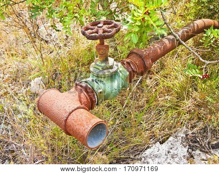 Detail of an old rusty hydraulic valve