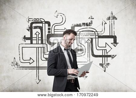 Man With Laptop And Tangled Arrows