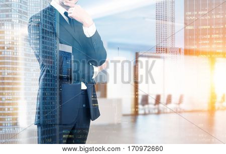 Close up of a businessman in a suit standing in his company office with a reception counter and a meeting room with glass walls. 3d rendering. Toned image. Double exposure