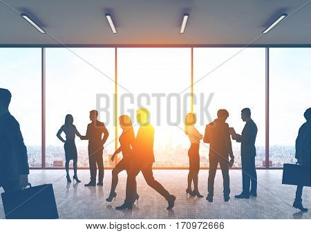 Business People Silhouettes In An Office Hall