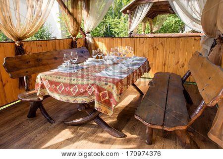 gazebo in nature. inside the gazebo served table