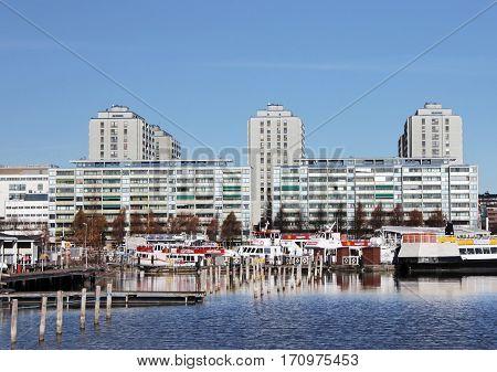HELSINKI FINLAND - NOVEMBER 3 2015: View of Merihaka - famous seashore residential area in central Helsinki Finland consisting of large high-rise concrete housing blocks November 2015