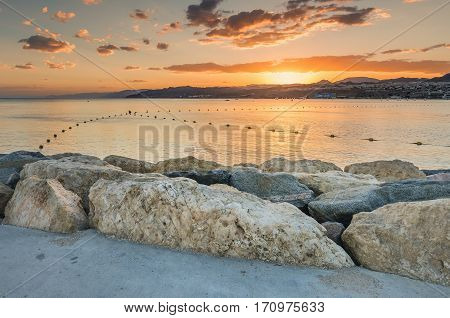 Stone pier at the central beach of Eilat (Israel) during colorful sunset