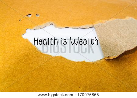 Health is Wealth concept on brown envelope