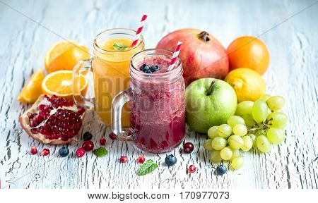 Berry and fruit smoothie, healthy antioxidant vitamin drink, diet and vegan food concept