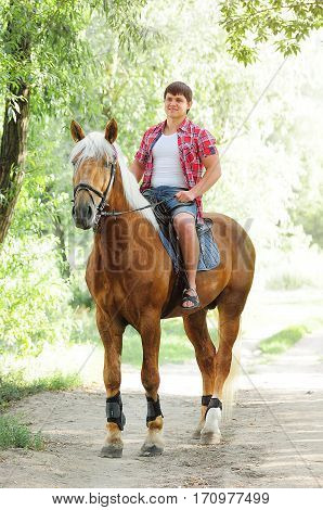Young In Shape Man On A Horse
