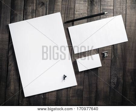 Blank stationery set with plenty of copy space for placing your design. Blank letterhead business cards envelope and pencil. Corporate identity mockup on vintage wooden table background.