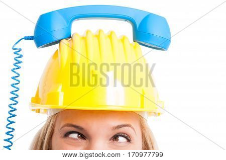 Woman Engineer With Telephone Receiver On Hat Looking Crosswise