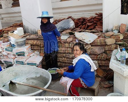 BANGKOK THAILAND - JANUARY 20.2013: Thai women-workers repairing temple in the monastery Wat Pho