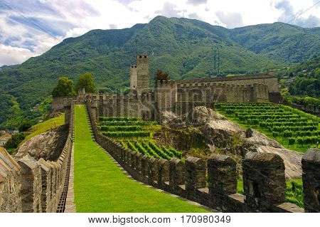 Perspective view of Murata - old city fortifications and Castelgrande castle in background. City wall of Bellinzona Ticino Switzarland
