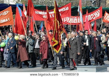 Tyumen, Russia - May 9. 2006: Parade of Victory Day in Tyumen. Members of Commubist Party of Russian Federation on parade