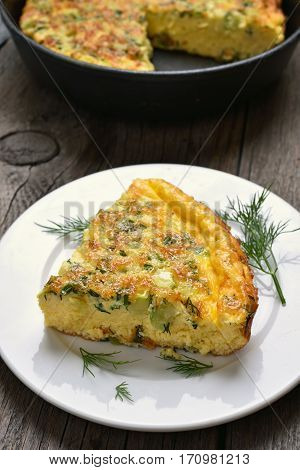 Omelette with herbs cheese and zucchini on plate