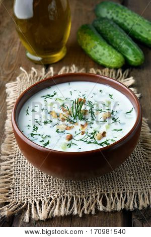 Yoghurt cold soup with cucumbers nuts and dill healthy diet food