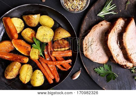 Fried vegetables in frying pan and sliced grilled meat top view. Focus on vegetables
