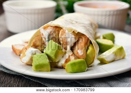Homemade chicken fajitas with avocado close up view