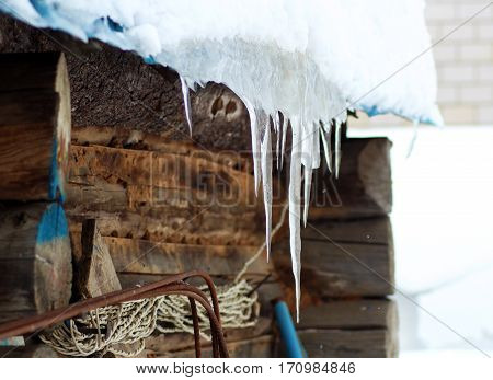 Large icicles on a wooden house a threat to lifewinter