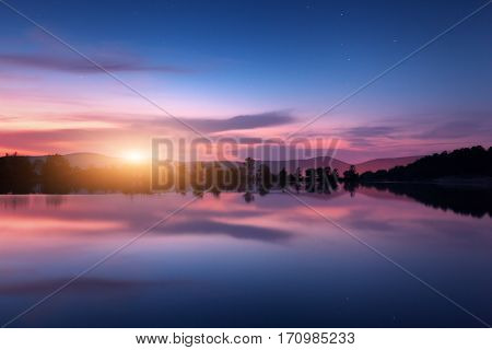 Mountain Lake With Moonrise At Night. Night Landscape