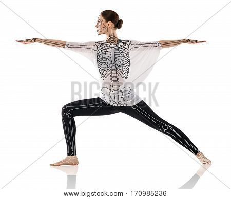Woman in a yoga pose, with semi-transparent skeleton over white background.