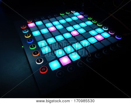 glowing Launchpad on black background for electronic dance music lovers