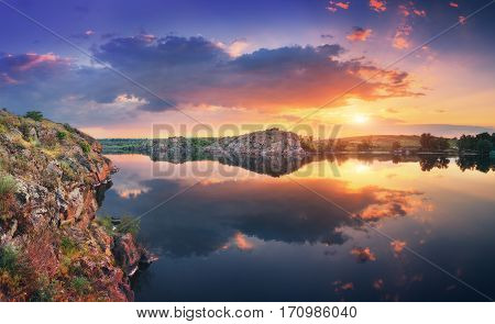 Lake Against Colorful Sky With Clouds At Sunset