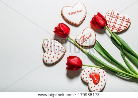 Flowers Tulips And Heart Shaped Gingerbread Cookie. Concept The Feast Day Of Holiday Valentine's Day