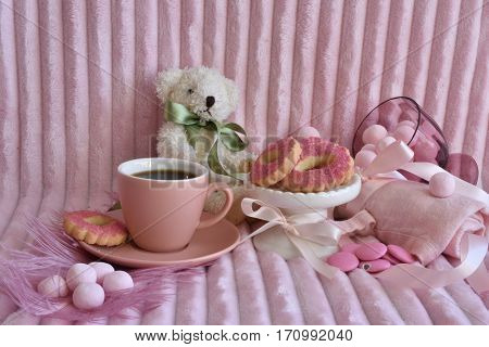 Pink Dream. pink cookies, pink candy, pink chokolate, pink feather, pink espressocup, pink background. ribbons, teddybear