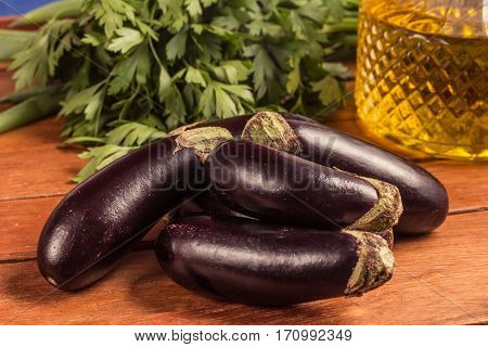 Baby Eggplant over a wooden table. Mini. Mini