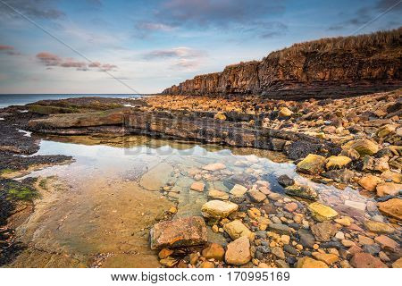 Rock Pool below Ebb's Nook, also called Beadnell Point, named from an old eighteenth century chapel, is a headland just north of Beadnell harbour