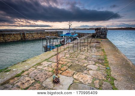 Beadnell Harbour North Pier, at Beadnell village on the Northumberland coastline, which is a small fishing harbour set into Beadnell Bay. Disused medieval Lime Kilns sit in the harbour