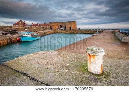 Beadnell Harbour and Lime Kilns, at Beadnell village on the Northumberland coastline, which is a small fishing harbour set into Beadnell Bay.