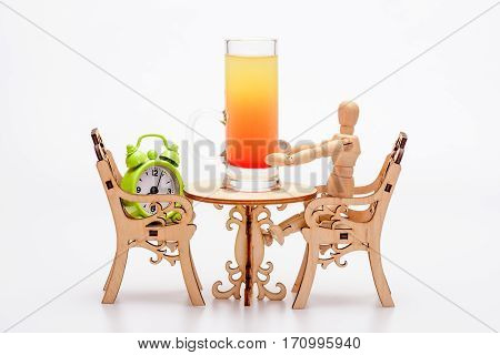 Alcohol Cocktail In Glass On Little Decorative Table With Chairs