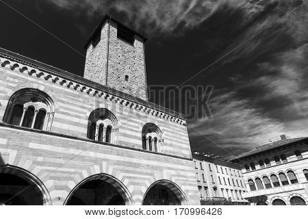 Como (Lombardy Italy): exterior of Broletto historic palace with tower built in 13th century. Black and white