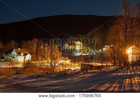 Winter night village a Synyak near the town of Mukachevo in the Zakarpattya region (Ukraine). February 2016