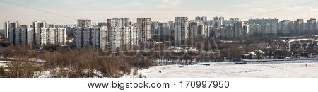 MOSCOW, RUSSIA - FEBRUARY 2017: Borisovskie Prudy - Borisovskie ponds, Borisovo district, Trinity Church, Orekhovo district, park and people on a walk, panorama photo
