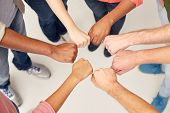 teamwork, friendship, international, gesture and people concept - group of hands making fist bump poster