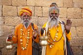 jain priest welcoming saluting in jaisalmer in rajasthan state in india poster