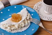 Casabe (bammy beiju bob biju) - flatbread of cassava (tapioca) with ricotta and honey and cup of coffee on wooden background. Selective focus poster