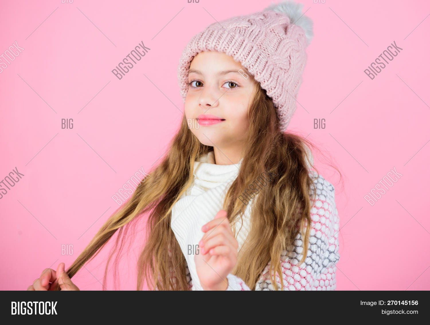fe4a0cf602e Girl Wear Knitted Hat Pink Background. Prevent Winter Hair Damage. Winter  Hair Care Tips