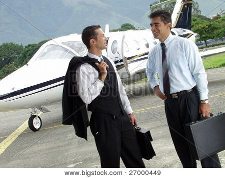 Business people working outsider on private jet background.