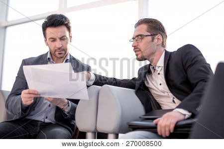 close up.lawyer discussing with client business documents.