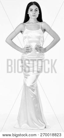 Woman In Elegant White Dress With Long Hair, White Background. Elegant Dress Concept. Girl On Pensiv