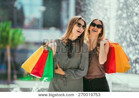 Happy Friends Shopping. Young Friends Enjoying Shopping In The City, Holding Shopping Bags.