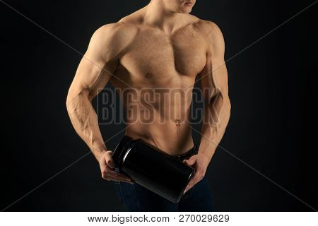 Diet for stronger body. Vitamin nutrition. Strong man hold vitamin bottles. Man with six pack abs. Muscle growing with anabolic steroids. Anabolic hormone increases muscle strength. Healthy diet. poster