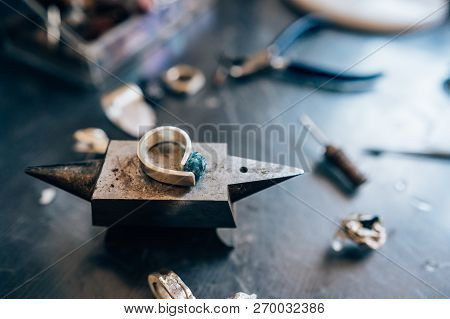 Different Jewelery On The Table From The Jeweler From A Close Angle