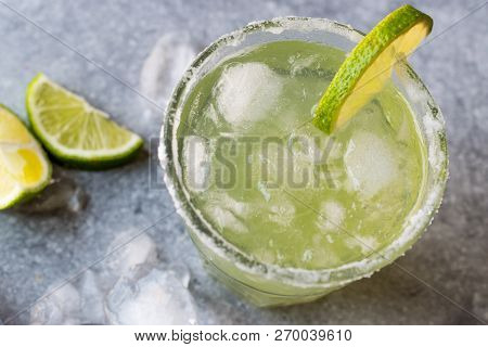 Classic Margarita Cocktail In Salted Glass With Lime And Crushed Ice.
